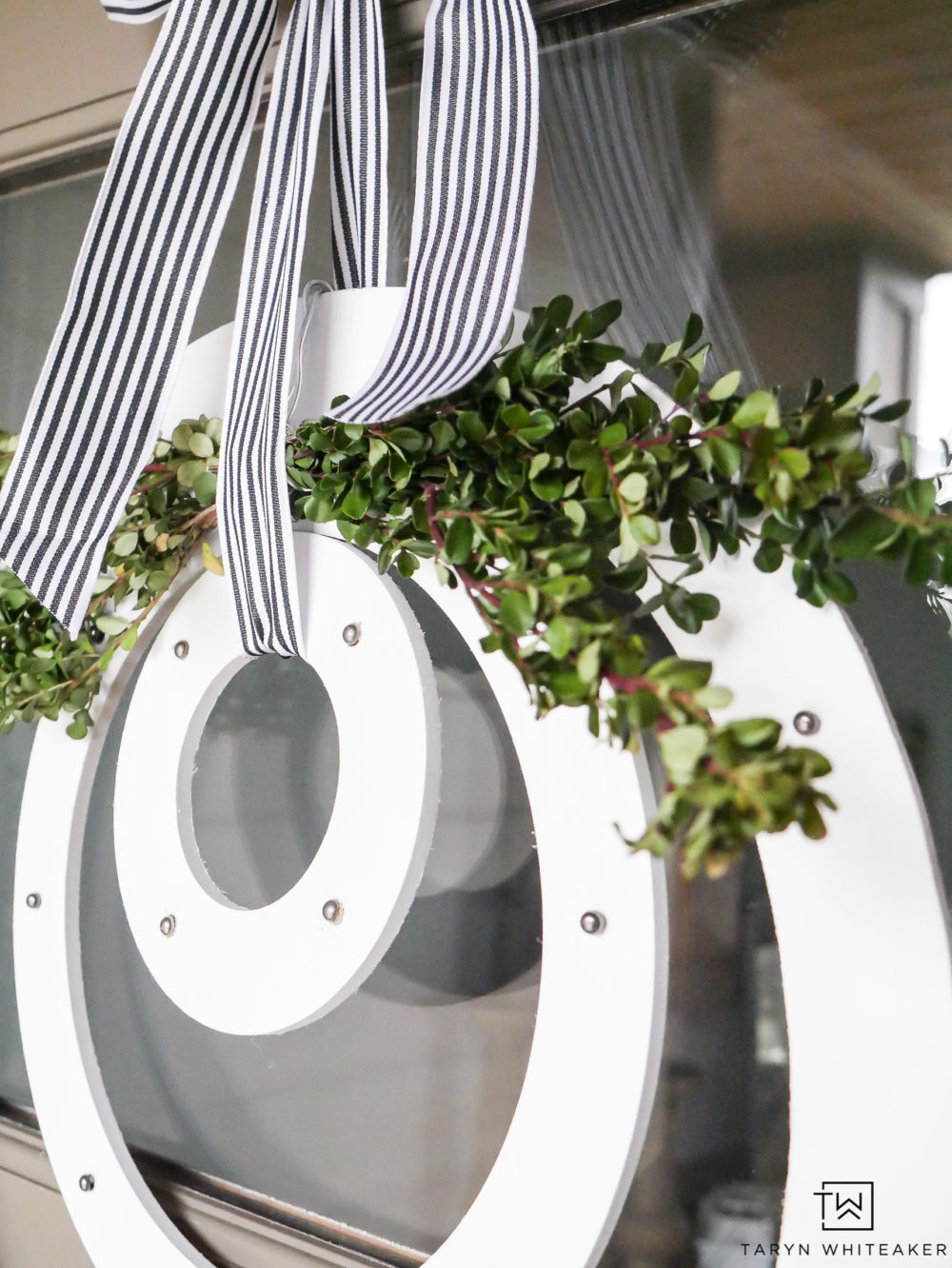 White spring wreath finished off with black and white ribbon and a little boxwood! A great fresh look for spring!