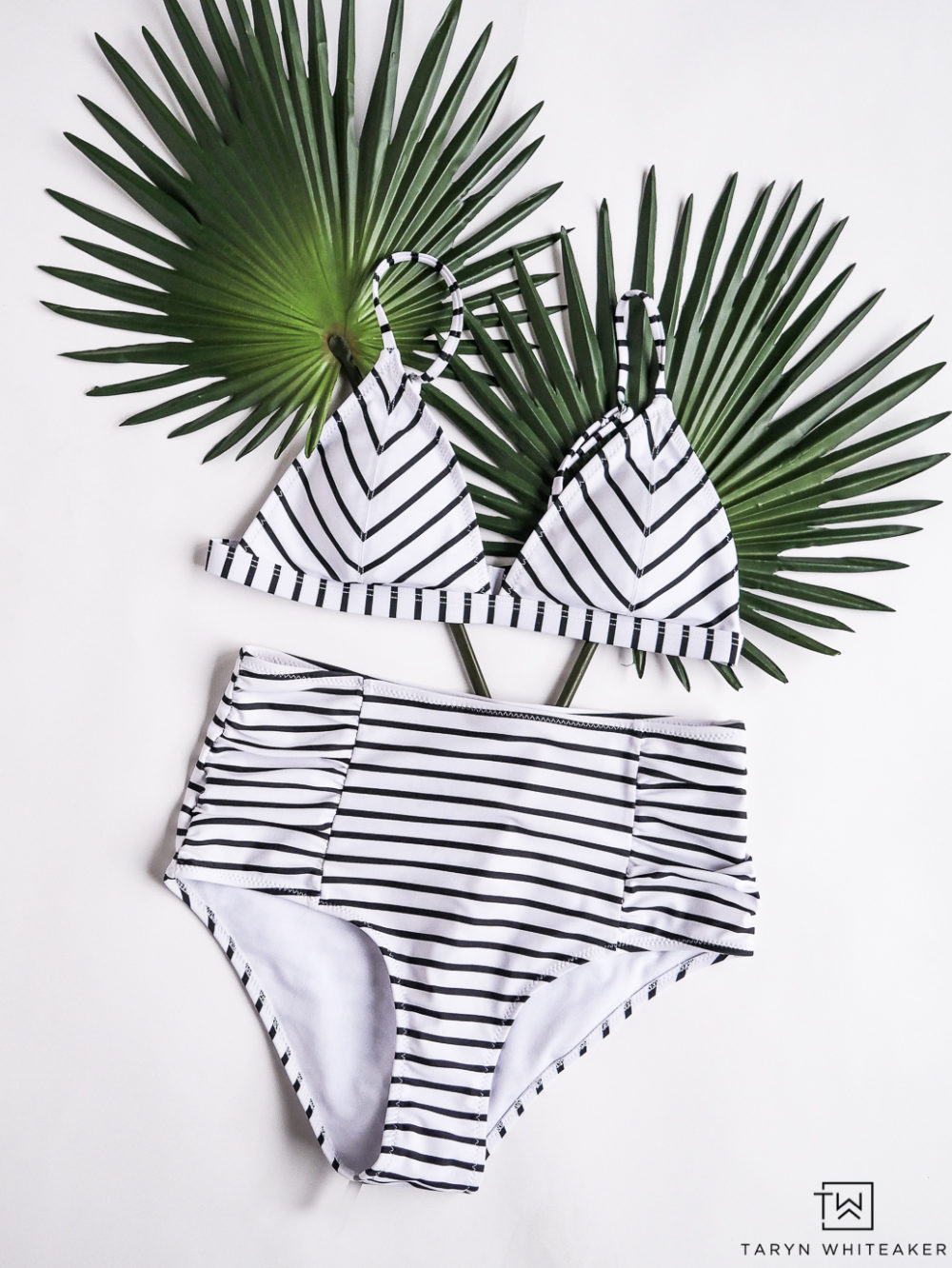 Vintage inspired black and white swim suit with high waisted bottoms! Only $25, click for more summer inspiration.