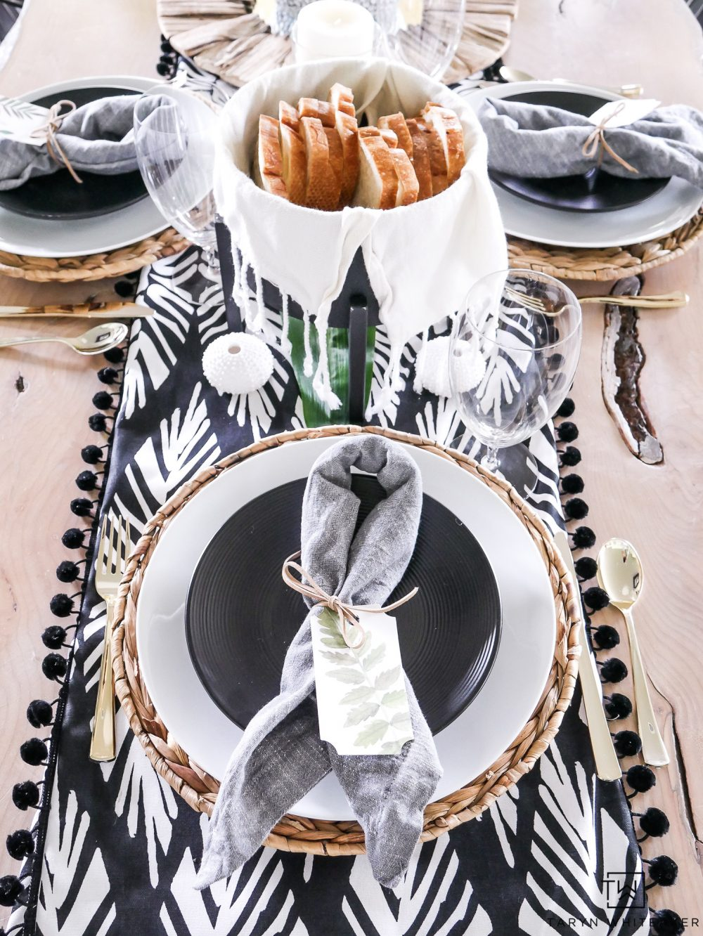 Black and white summer party decor! This tropical dinner party decor is a modern take on a fun summer theme!