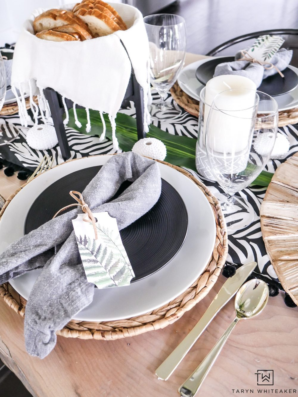 Black and white decor with pops of greenery! This cute summer table decor is easy to put together even with a DIY table runner!