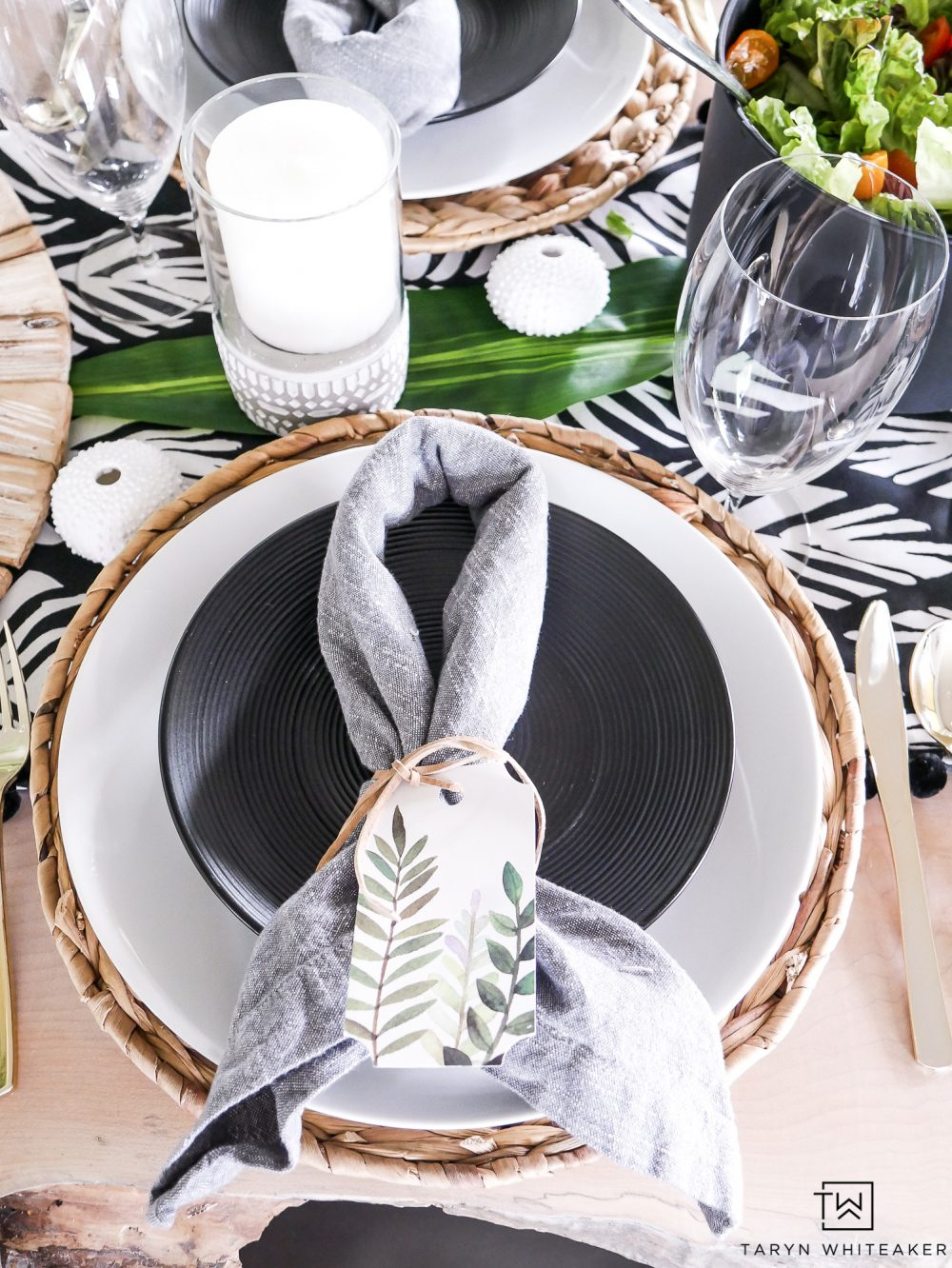 Black and white summer table setting with pops of greenery!