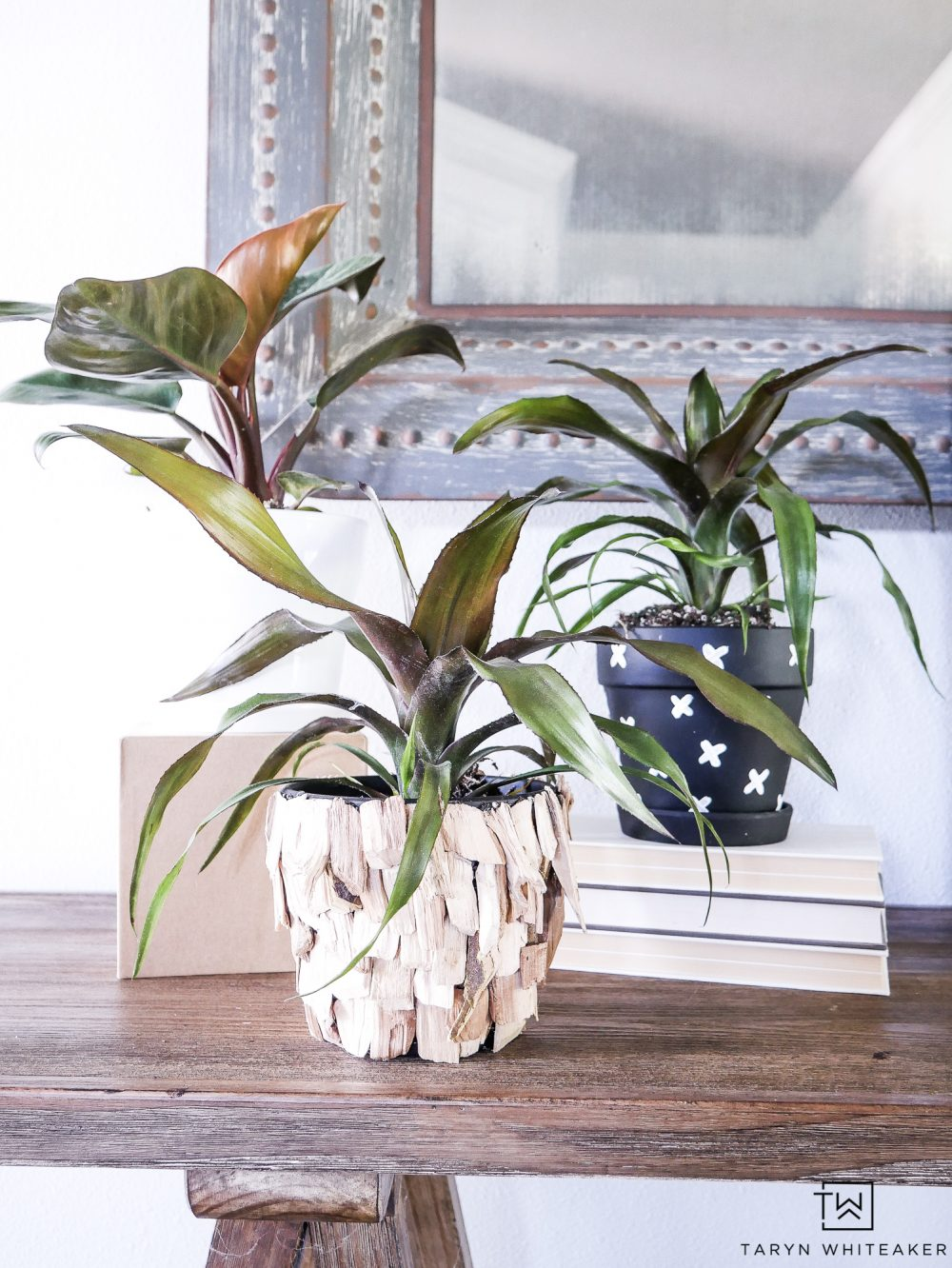 These DIY Indoor Plant Pots have such a great boho chic look to them! The wood chip pot gives it a great topical look.