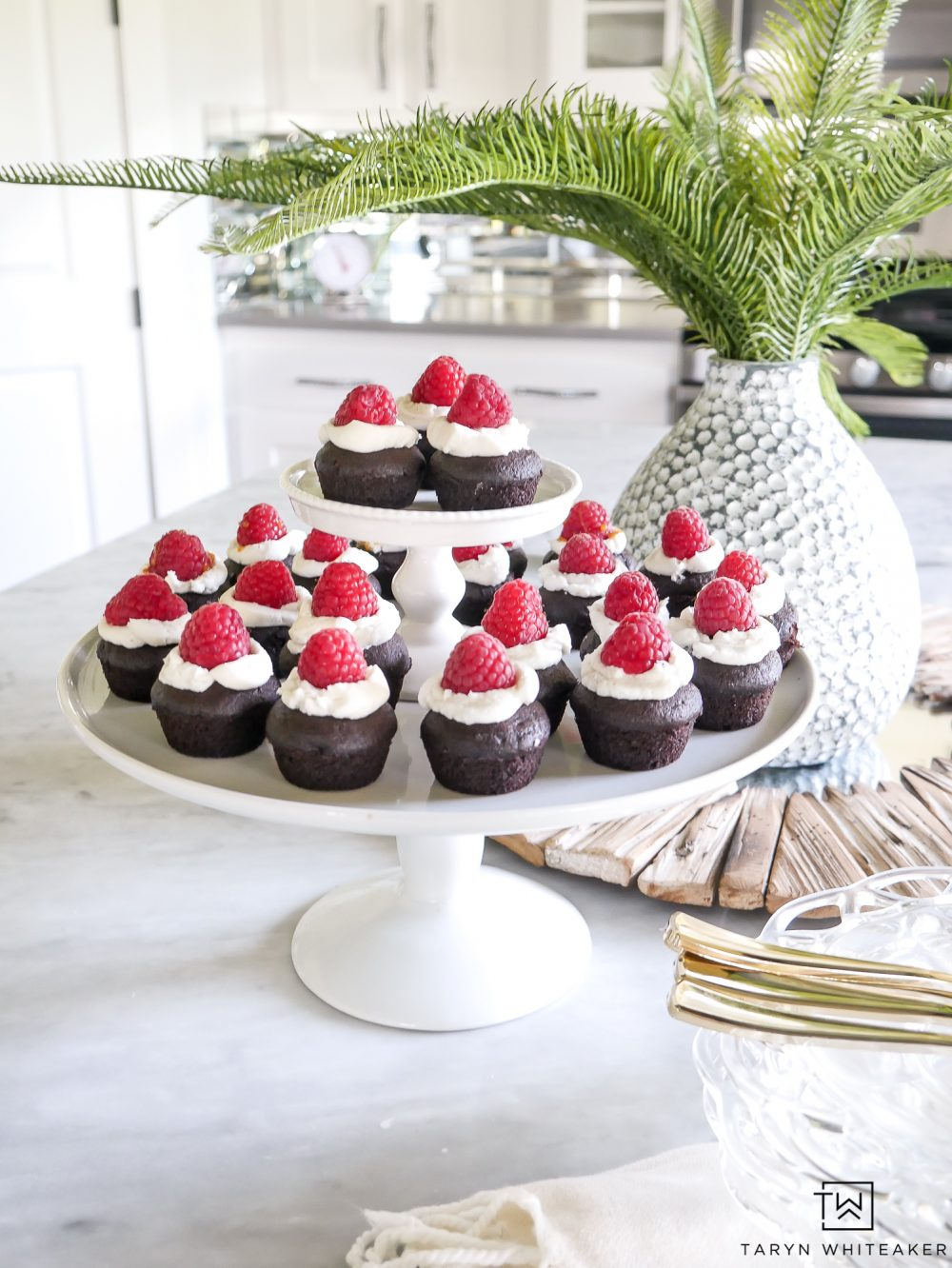 Easy Mini Chocolate Cupcakes With Caramel Filling and raspberries on top! Super simple recipe for bite size desserts!