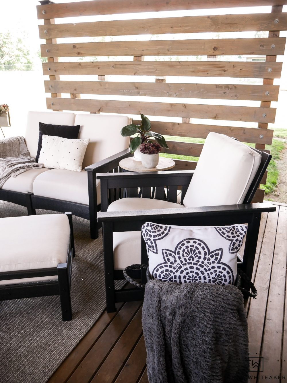 Outdoor Chair with matching Ottoman! Such a pretty outdoor living space and privacy screen.