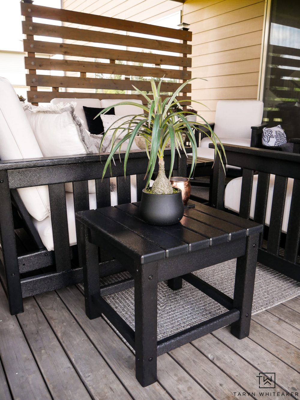 Black patio furniture with matching end tables.