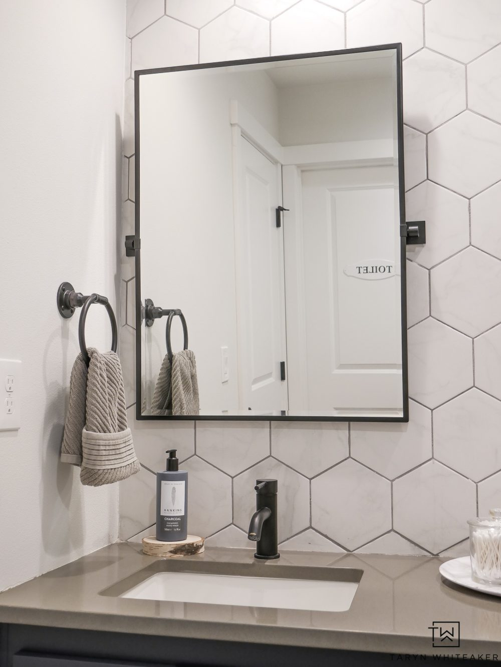 Love black pivot mirrors in a bathroom!