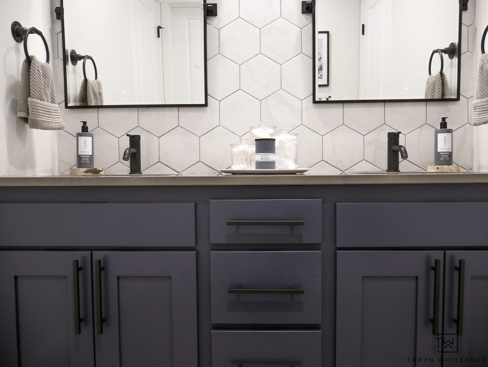 Modern Rustic Bathroom makeover with industrial black fixtures and charcoal blue cabinets!