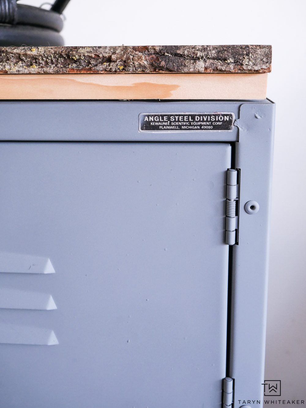 Upcycle a vintage locker with spray paint and a new wood top!