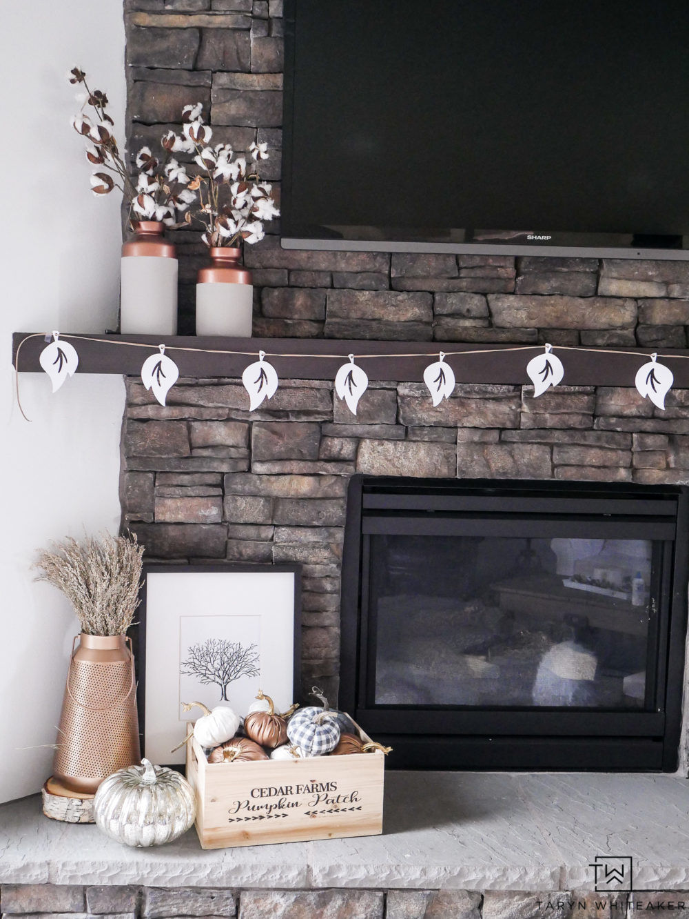 Such a sweet rustic glam fall mantel! This DIY leaf garland is so easy to make using your Cricut machine and little leather rope.
