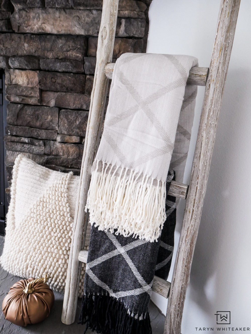 Cute way to display blankets for fall around the fireplace.