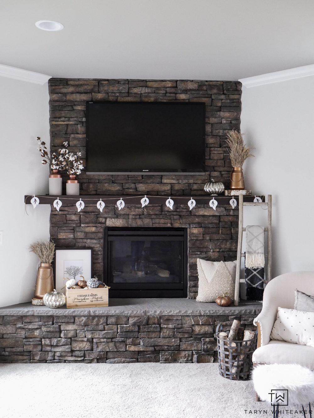 Dress up your family room for fall with this rustic yet chic neutral and copper fall mantel decor. Get the look by mixing lots of textures and metals!