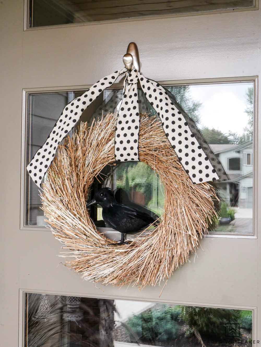 Super easy Halloween Wreath made with a twig wreath, black crow and cute black polka-dot ribbon!