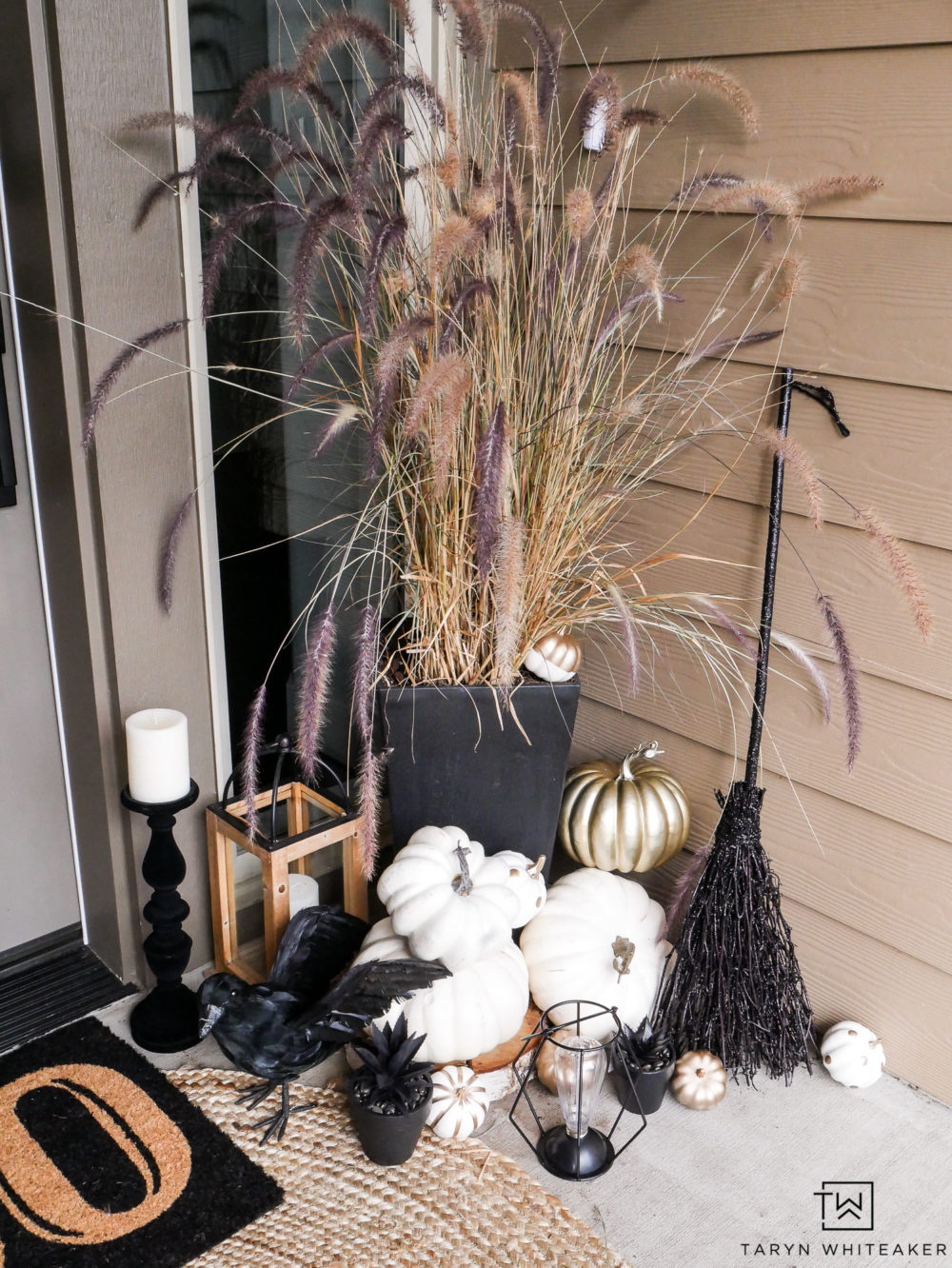 Easily transition your fall porch into Halloween with lots of black and white pumpkins, creepy crows and lights!
