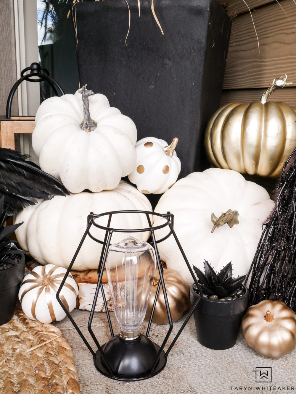 Love this cute and class Halloween porch with industrial lanterns and white and gold pumpkins!