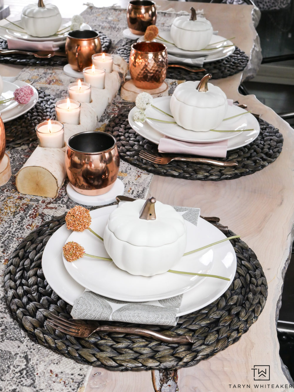 This early fall tablescape is a great example of how you can use just about any earth tone to create a beautiful fall tablescape. love the mixture of wicker placemats against the ivory ceramic dishes and subtle pops of color.