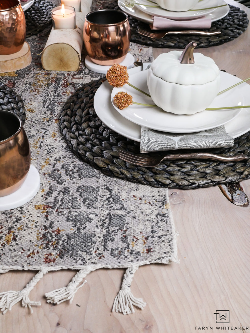 A fall table filled with soft earth tones for an unconventional fall tablescape. Love the mix of gray and orange for a modern fall table filled with texture.