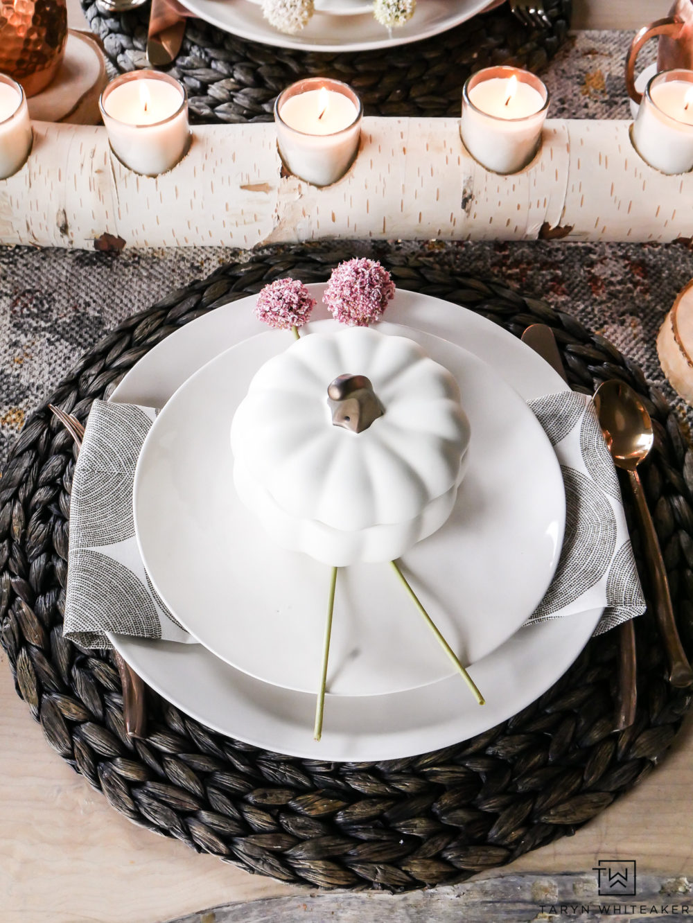 Create and elegant and unique fall tablescape using earth tones and natural textures. Love these blush pink fall table decorations. Such a pretty table for early fall.