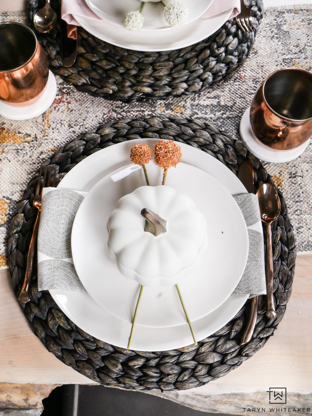 So many beautiful natural textures all in one place. Love how the smooth ivory dishes are paired with the pops of patter, and wicker chargers.