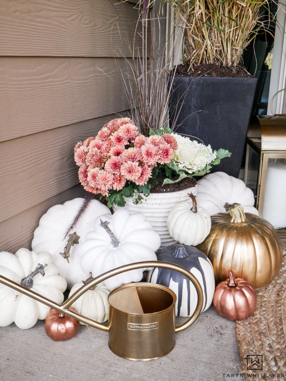 This gold watering can is too cute! Love how it adds a little texture to the gold fall porch.