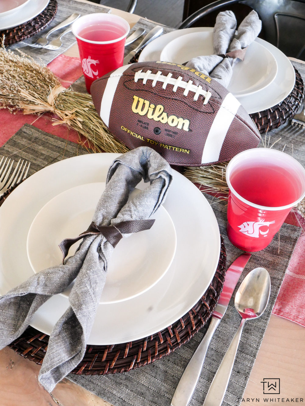 Create a fun football theme centerpiece using real footballs and leather napkins ties!
