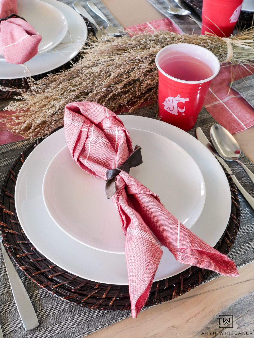 Simple, football themed tablescape featuring fall favorite with wheat grass, red solo cups and cute napkins.
