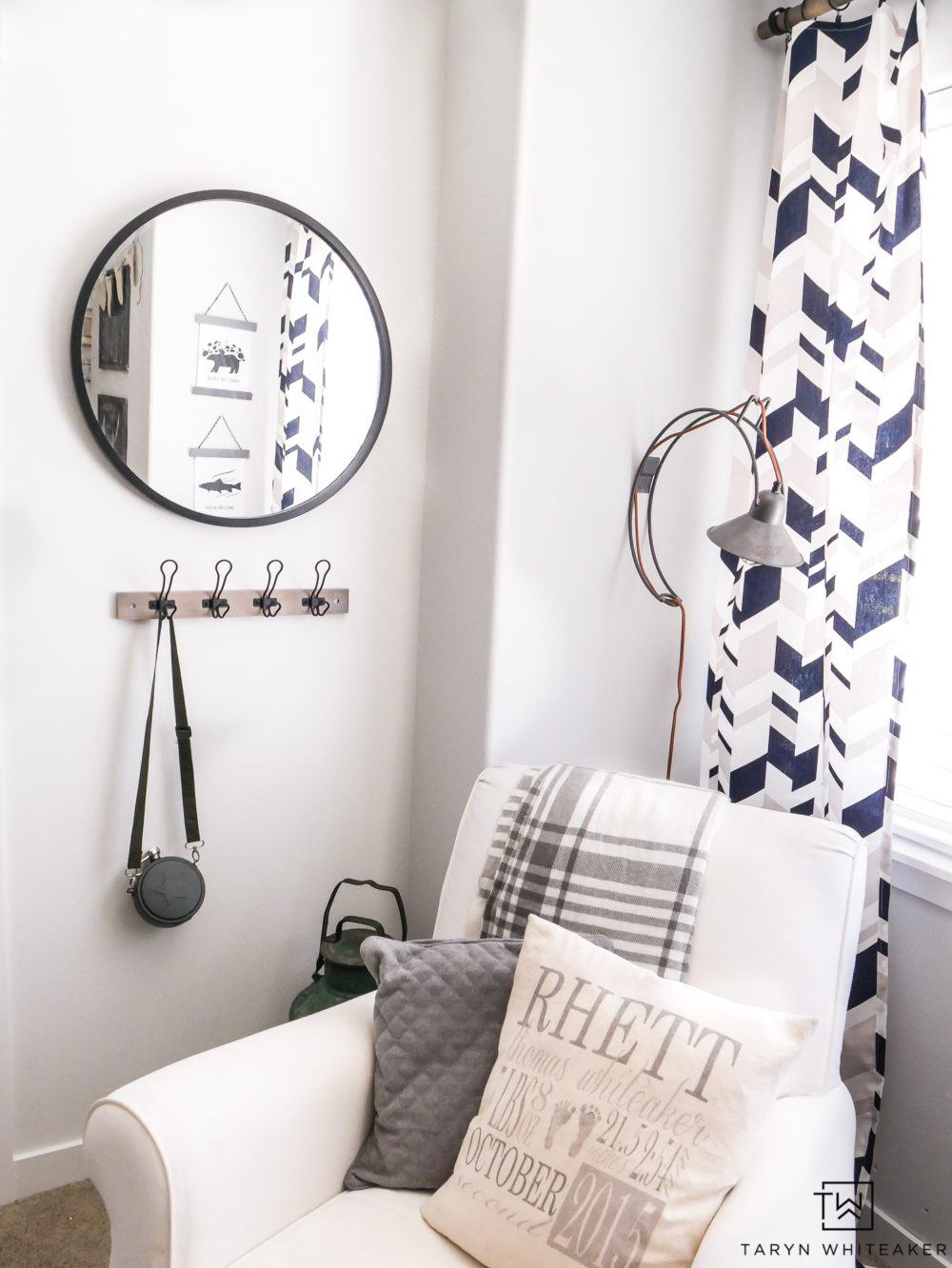 Cozy reading corner in boy's room! Love the circle mirror and geometric curtains.