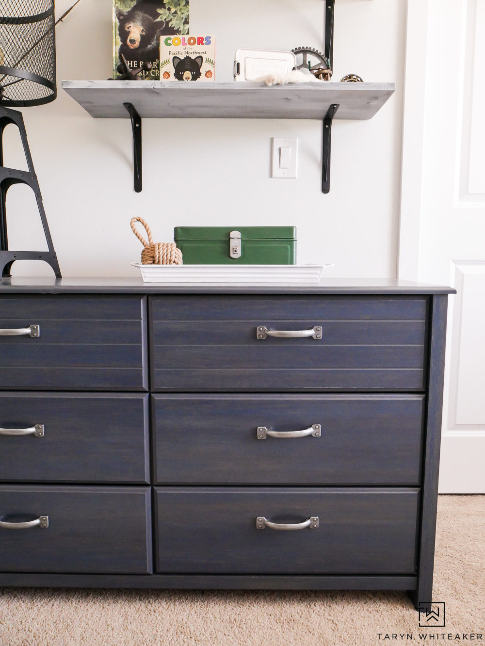 This distressed blue dresser is the perfect pop of color for this space!