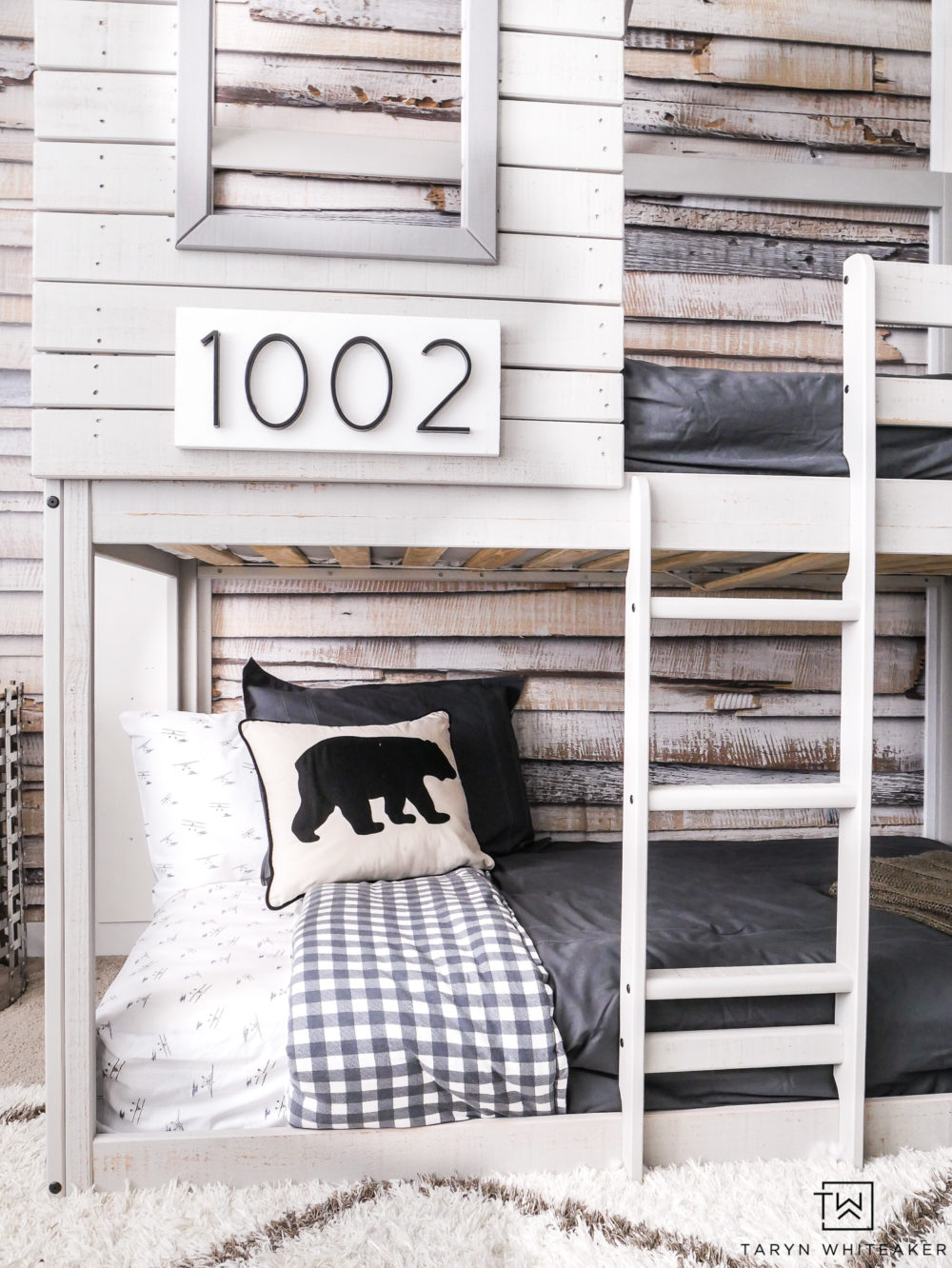 "Personalize your bunkbed by using special numbers as ""house numbers"". This cabin like bunkbed is too cute for this outdoor inspired boys room."