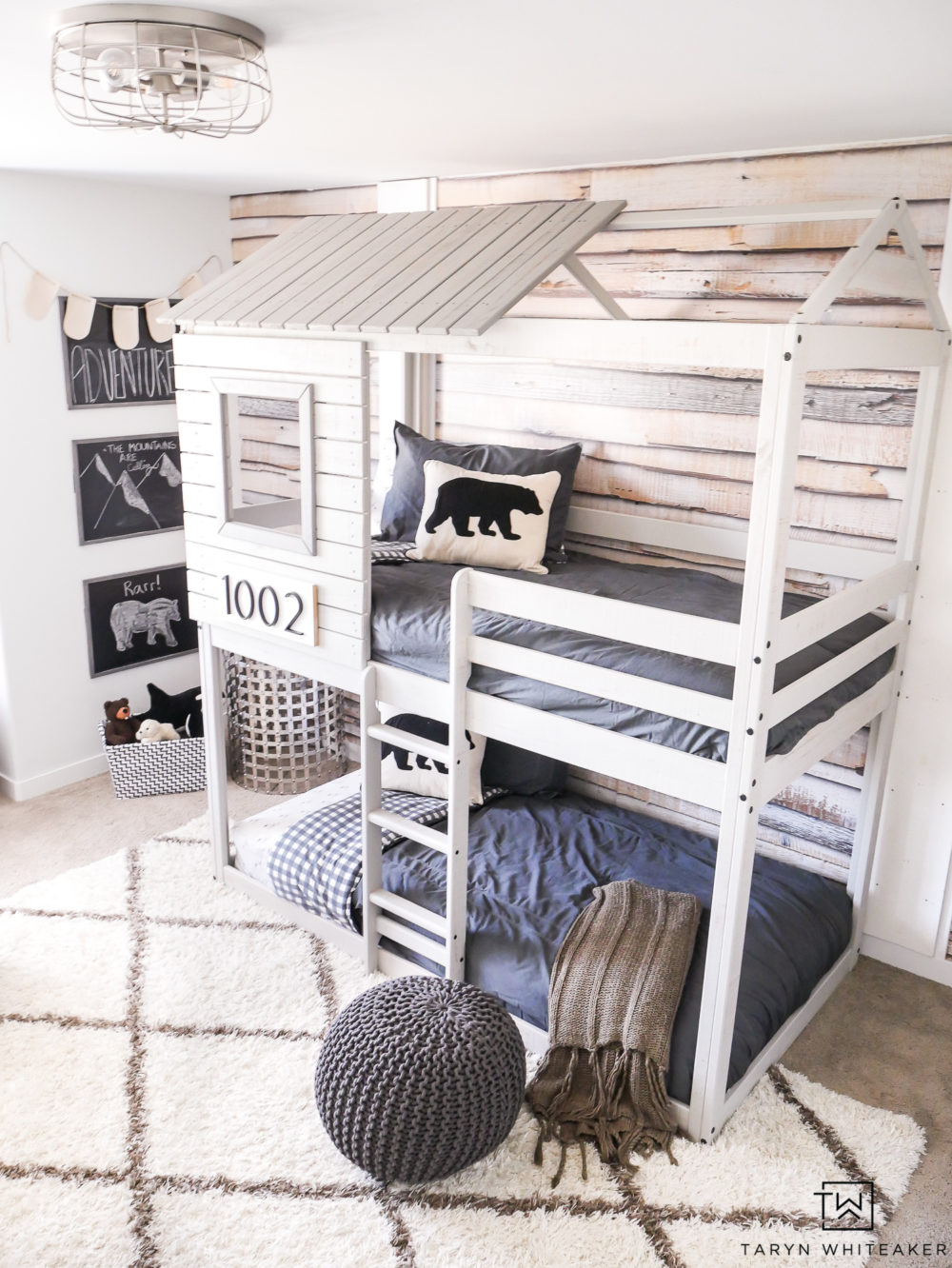 Take a tour of this Modern Adventure Boys Bedroom complete with a treehouse bunkbed and bear accents.
