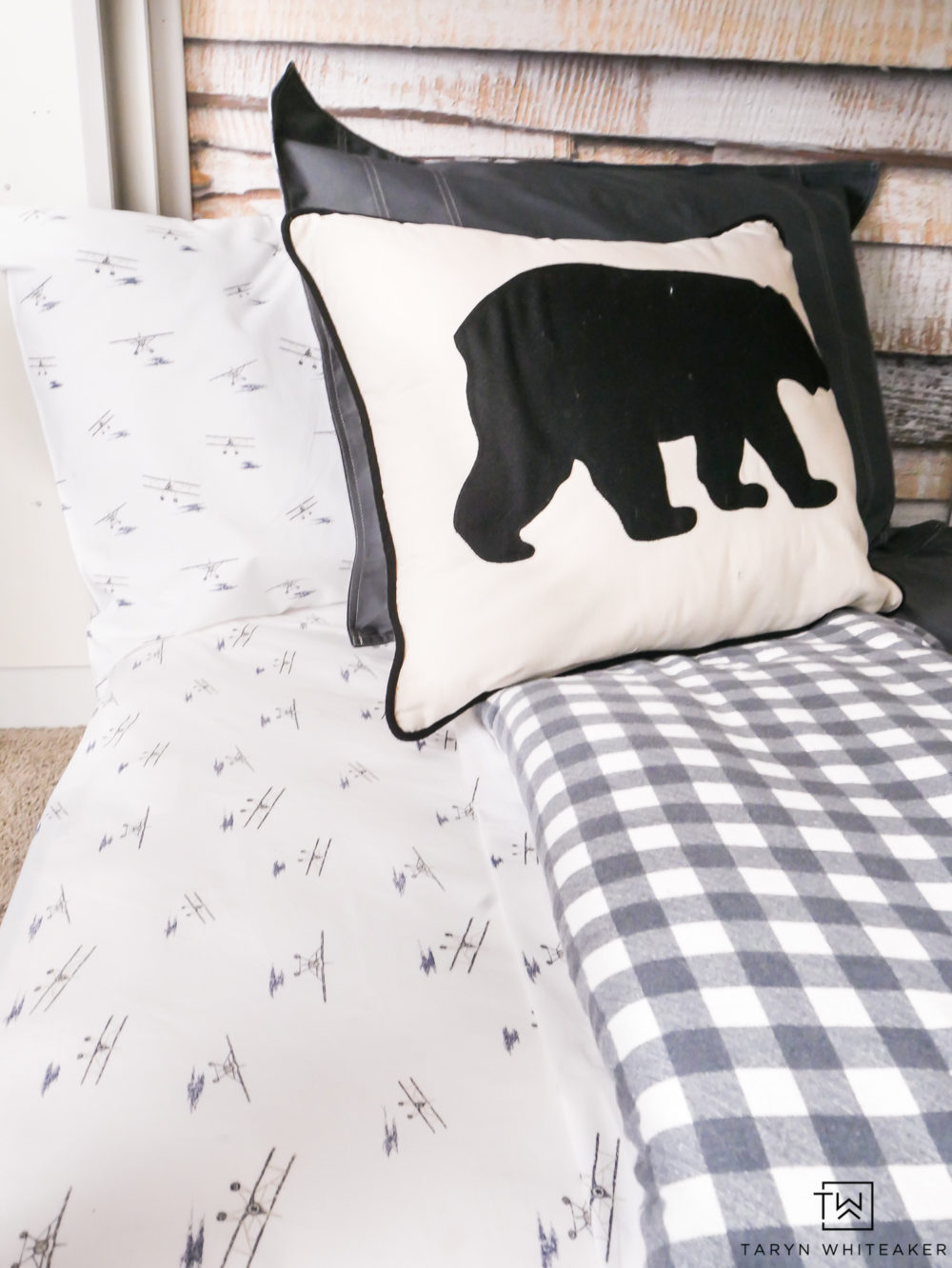 Adorable Eddie Bauer sea plane sheets with black bear accent pillow. Love this modern cabin inspired bedding.