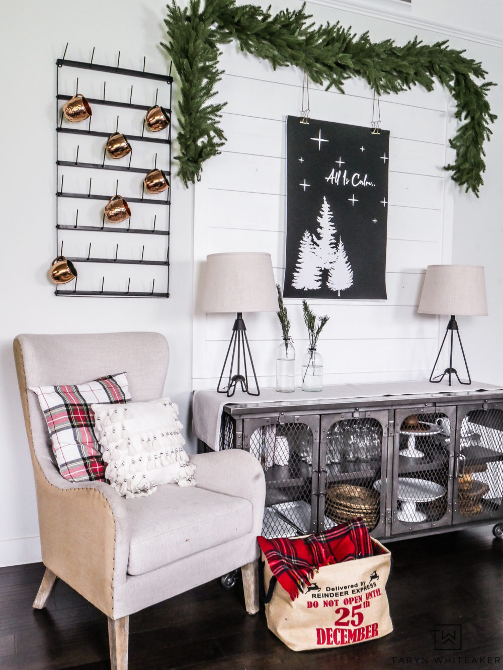 Cozy and modern Christmas display with greenery and pops of plaid!