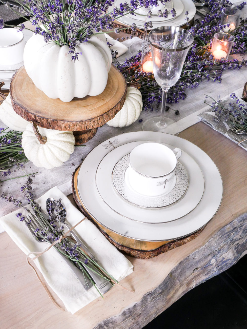 Create a classy and elegant Lavender Fall Tablescape filled with blooms from your own yard! Give it a fall look using white pumpkins and tea light candles.