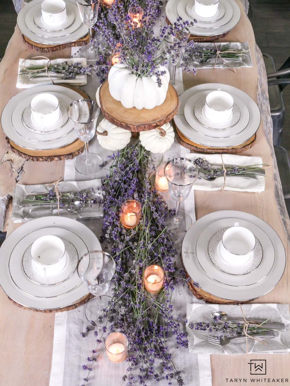 This beautiful elegant fall tablescape is compete with a fresh lavender table runner and pumpkin centerpiece!