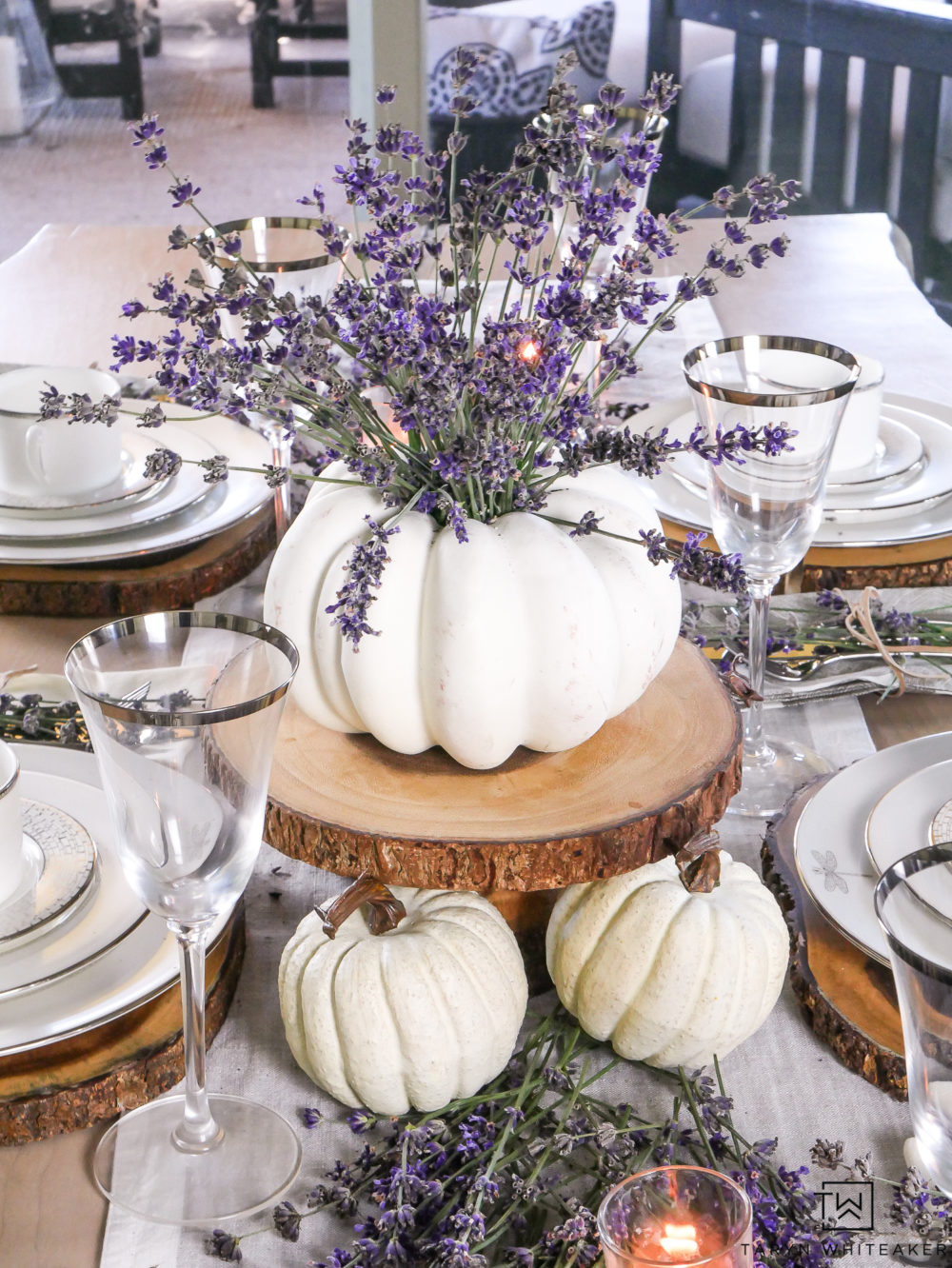 Create a simple and beautiful pumpkin centerpiece using white pumpkins and sprigs of lavender!