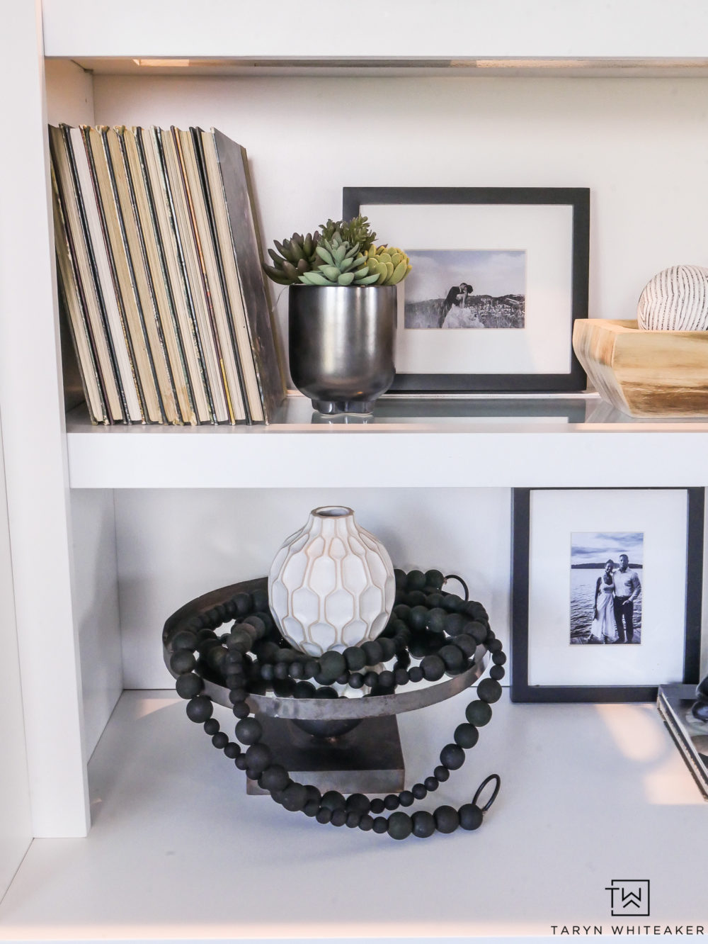 Black and white decor on open shelves.