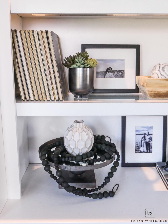 Black and white decor on open shelves.