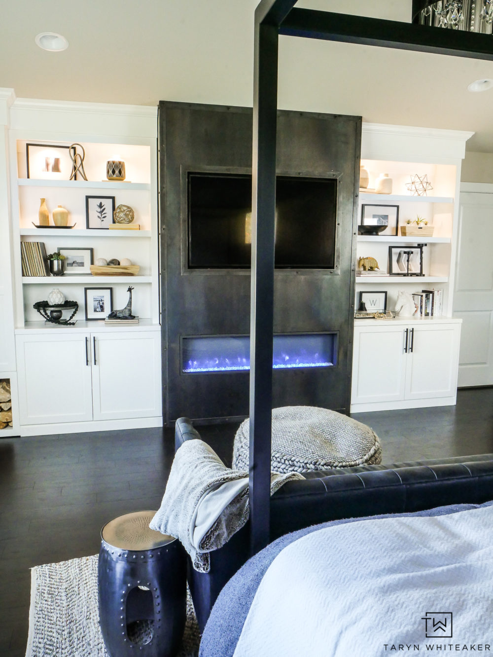 Turn your master bedroom into a luxury retreat by adding a fireplace and custom built ins! Great for storage and keeping your bedroom cozy.