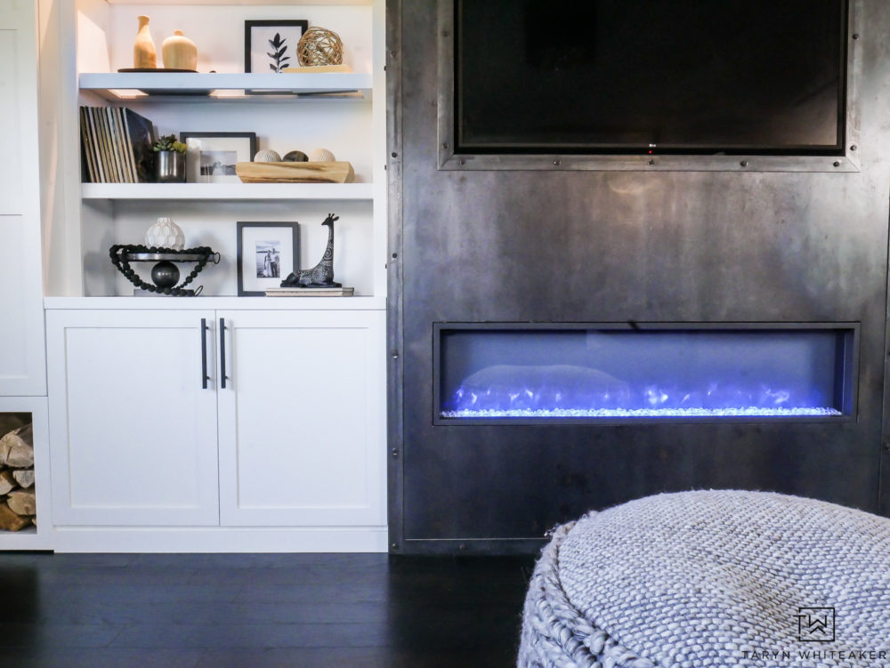 Beautiful and unique industrial raw steel fireplace with with custom built ins!