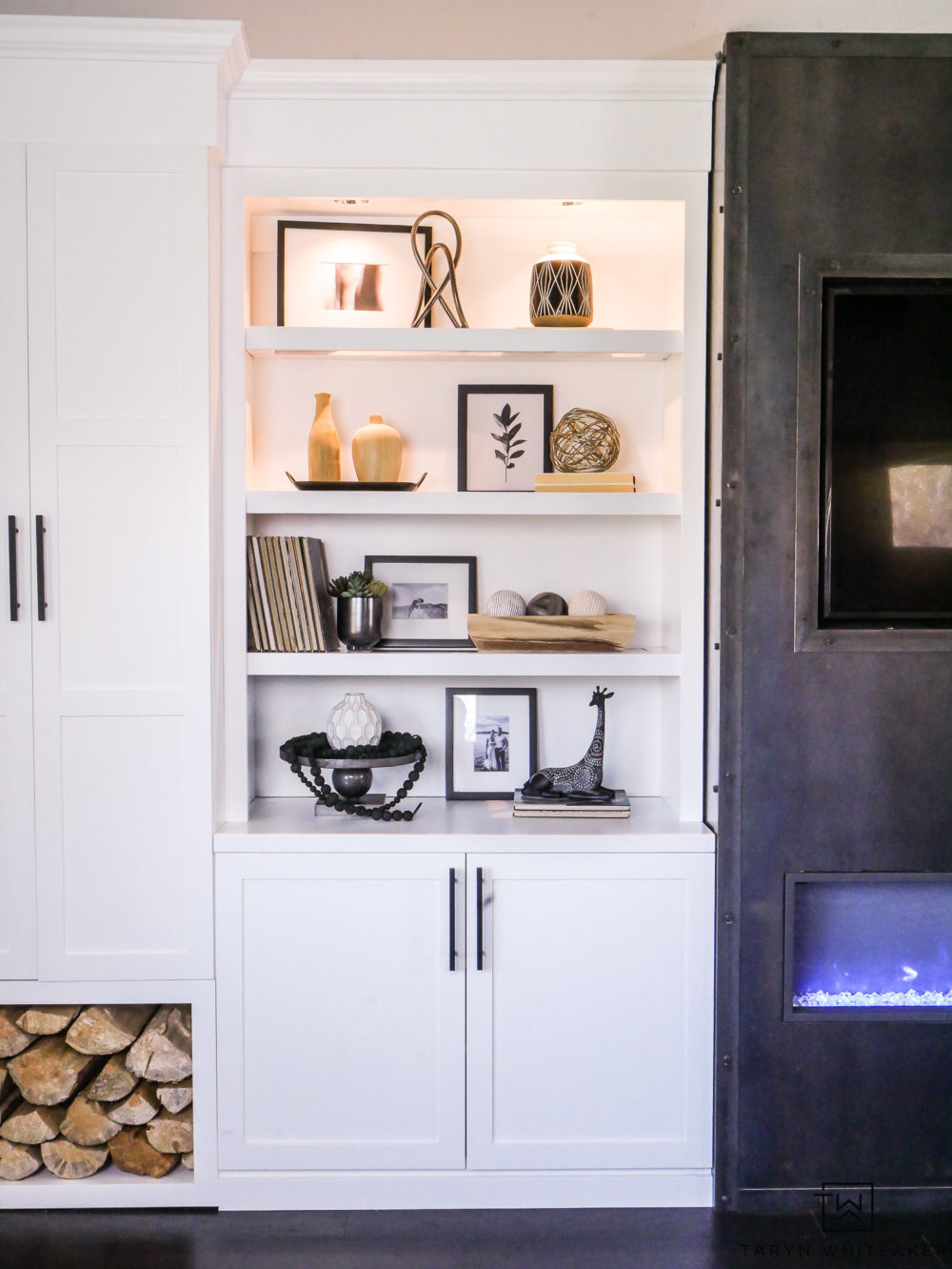 White craftsman built ins with built in lighting. Love the wood storage for rustic look.