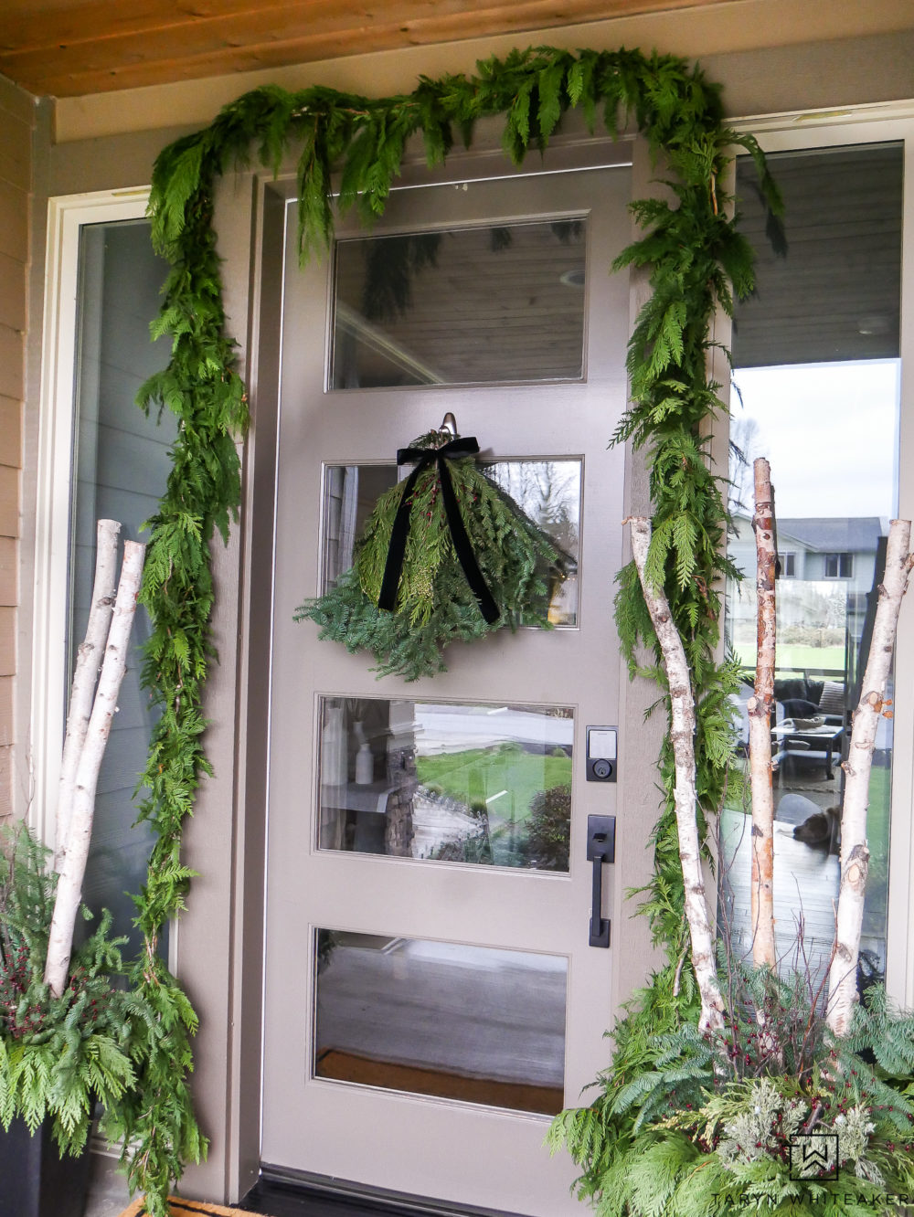 Hang fresh garland around your front door for the holidays. Simple greens from grocery store can make such a difference!