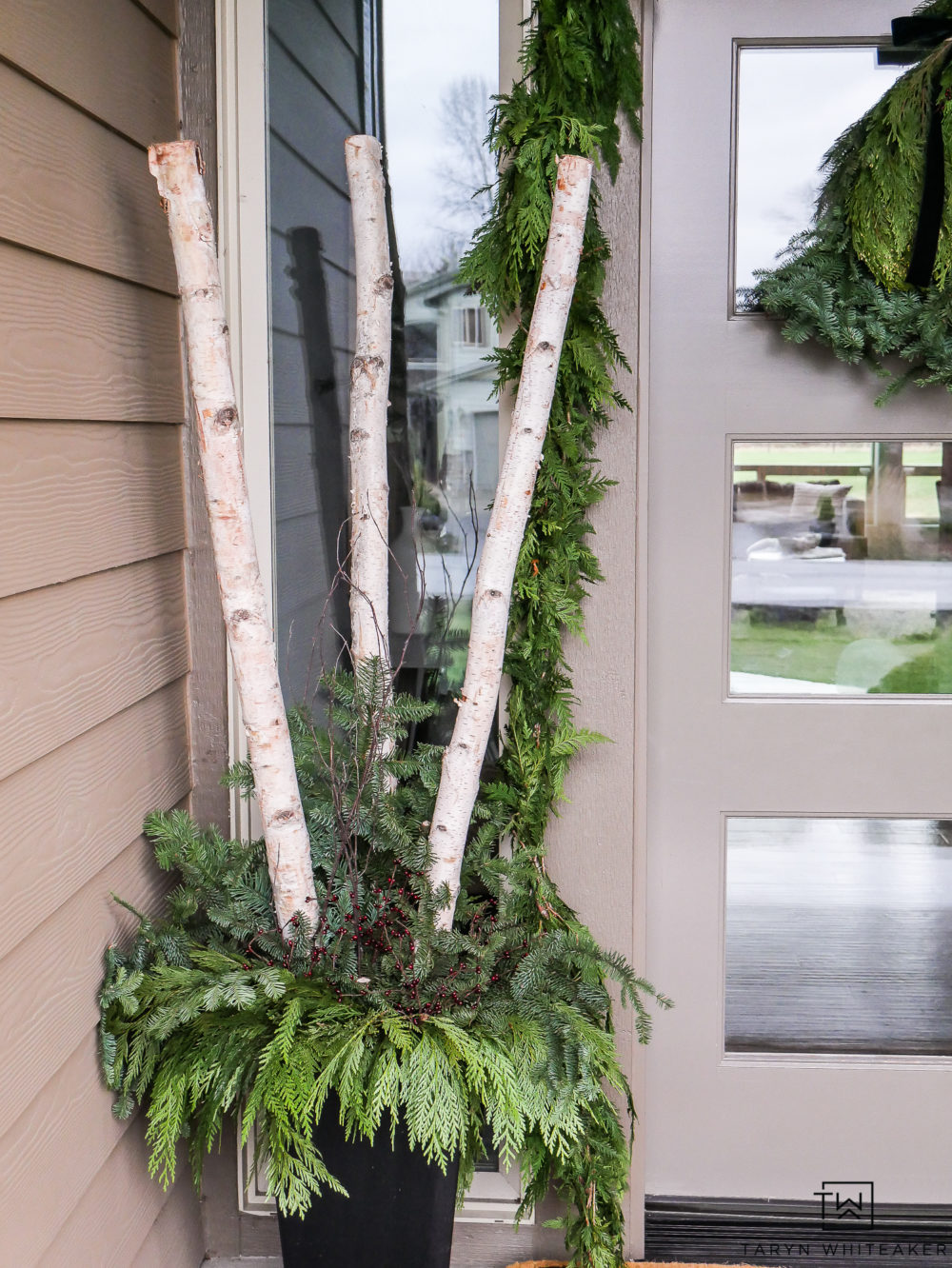 Create your own DIY Christmas Planters filled with fresh greens and birch logs. Love this traditional yet modern look for the holidays.