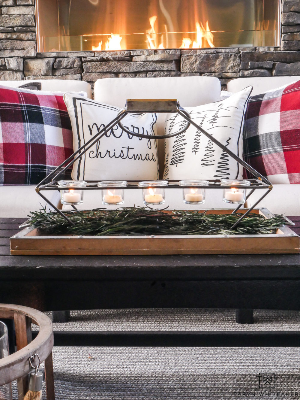 Get tips for decorating your outdoor space for the holidays! This Cozy Christmas Outdoor Living Space is all sorts of cabin chic !