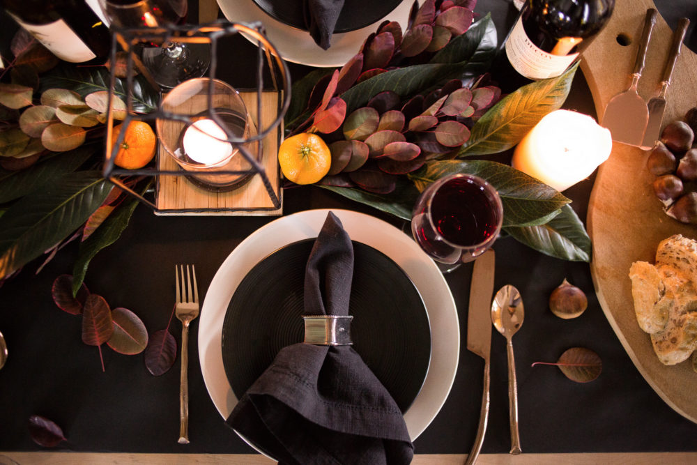 Thanksgiving tablescape with deep rich earth tones and pops of copper.
