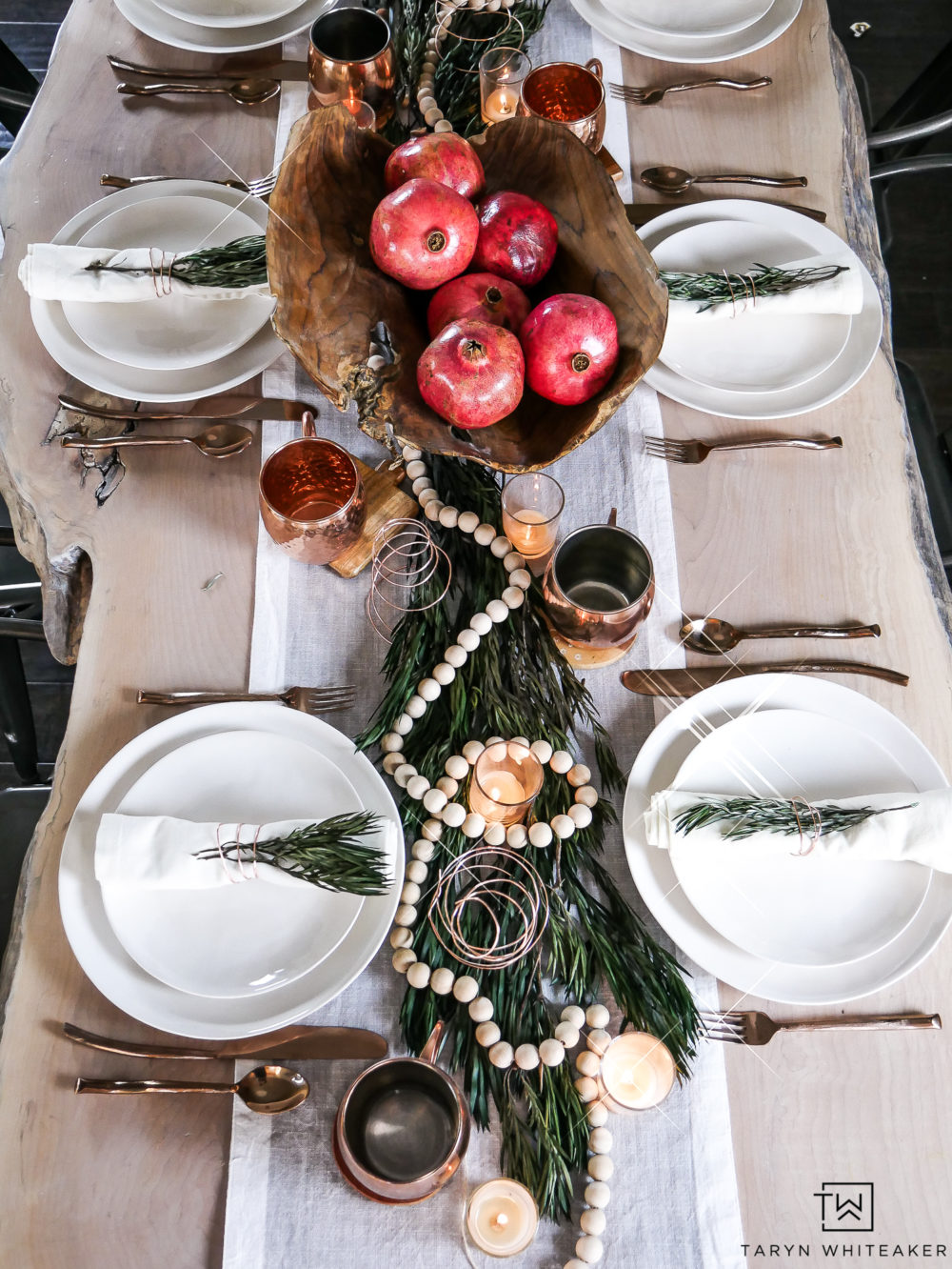 Organic inspired modern Christmas table! Mixing creamy whites and pops of red and green.