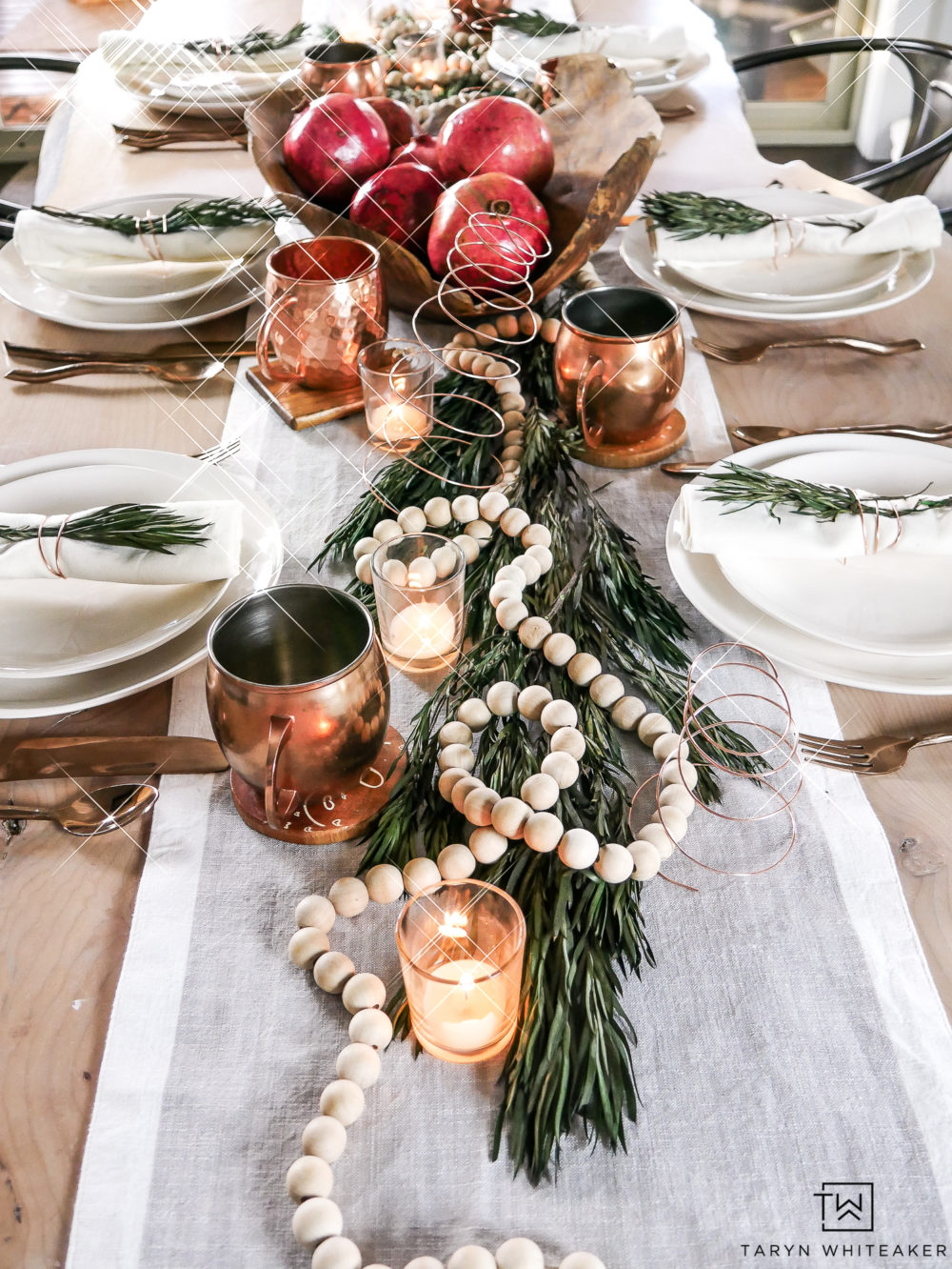 Neutral and elegant Holiday Table Decor using natural elements and creamy whites. Love the mixture of the red pomegranates and greenery.