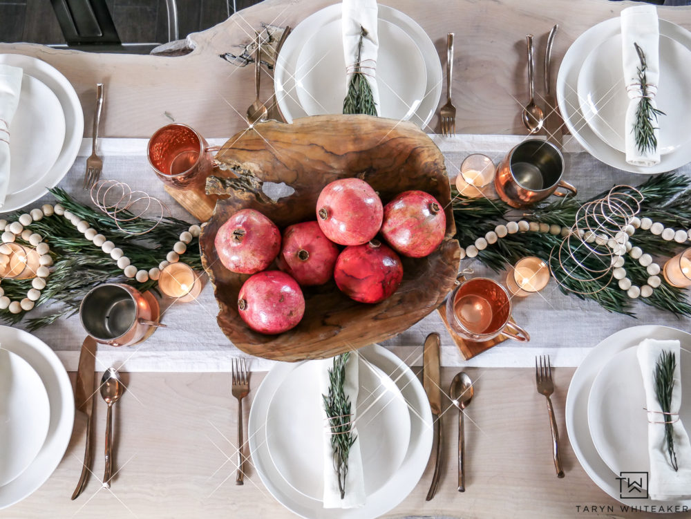 Less is more. Click to take a closer look at the organic inspired modern Christmas Table Decor filled with natural wood and natural elements.