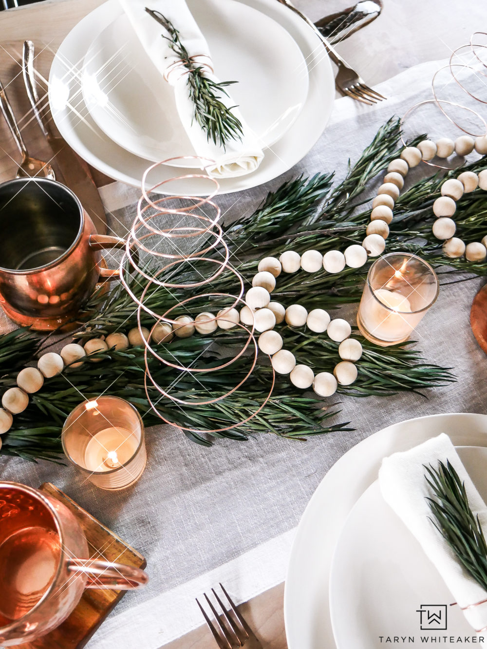 Simple Christmas centerpiece ideas using greenery, natural wood and pops of copper.