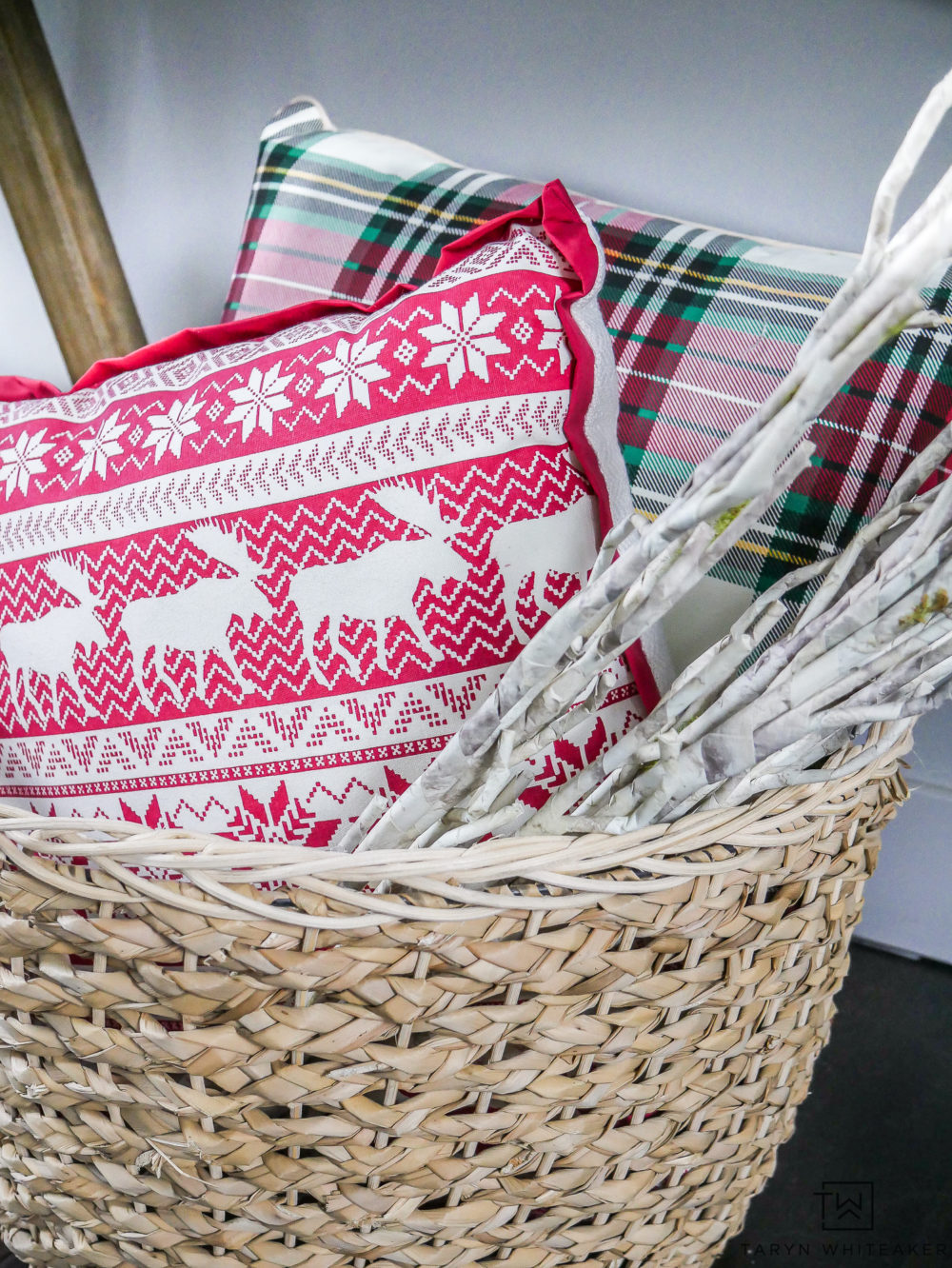 Christmas Pillows in a basket with twigs