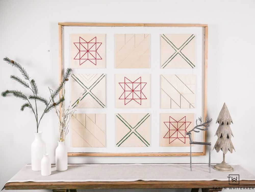 Create your own DIY Wood Christmas Sign using wood canvases and a little paint! Such a fun Scandinavian Inspired Christmas decor piece!