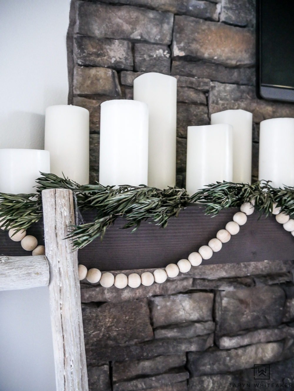 simple white candles on the Christmas mantel.